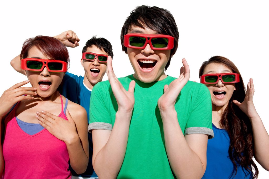Stock Photo: 1839R-32291 Young people waching 3D movie