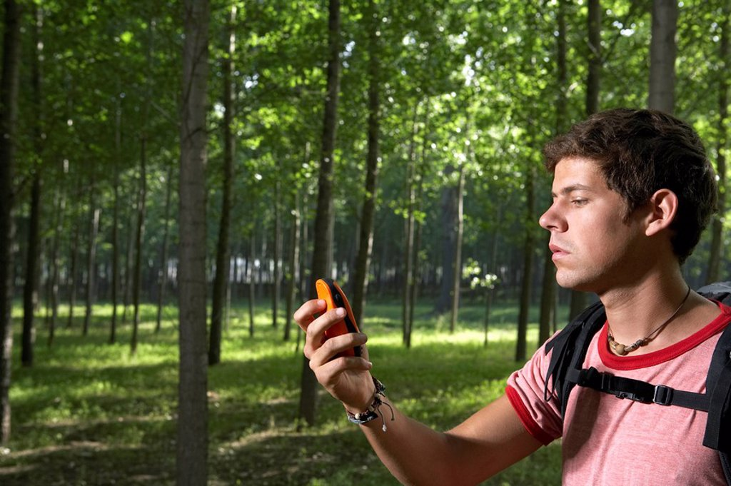 Man Looking At GPS System : Stock Photo
