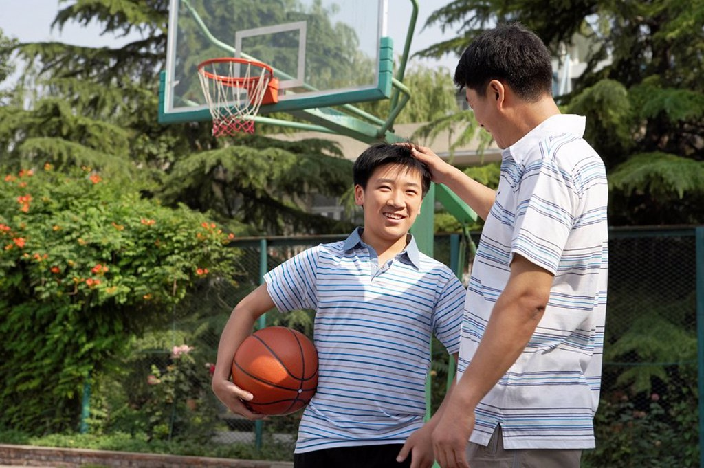 Stock Photo: 1839R-3366 Father And Son On Basketball Court