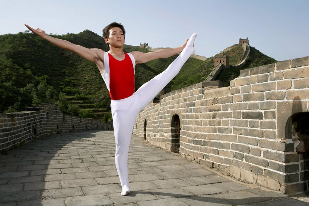 Stock Photo: 1839R-3400 Gymnast Stretching On The Great Wall Of China