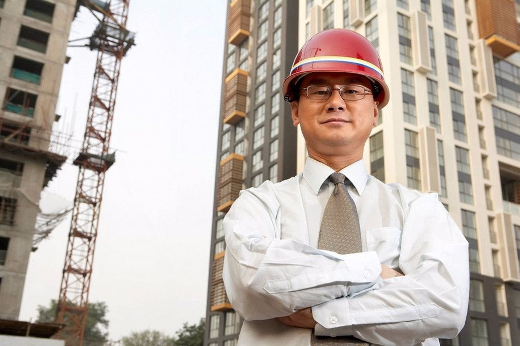 Stock Photo: 1839R-3521 Construction Contractor Standing On Building Site