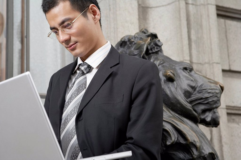 Businessman Looking At Laptop Computer : Stock Photo