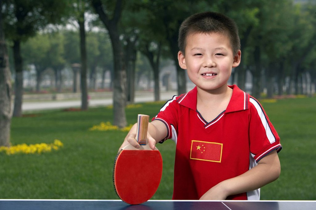 Stock Photo: 1839R-3741 Boy Playing Ping Pong