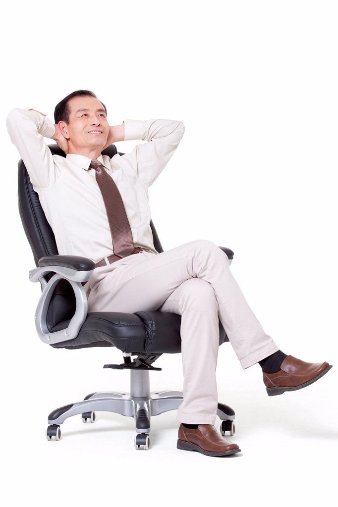 Stock Photo: 1839R-40522 Senior businessman leaning back in office chair