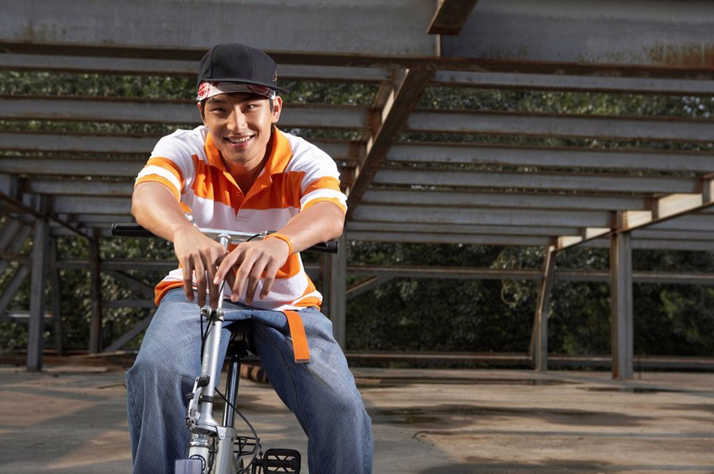Stock Photo: 1839R-4093 Man Riding Bike