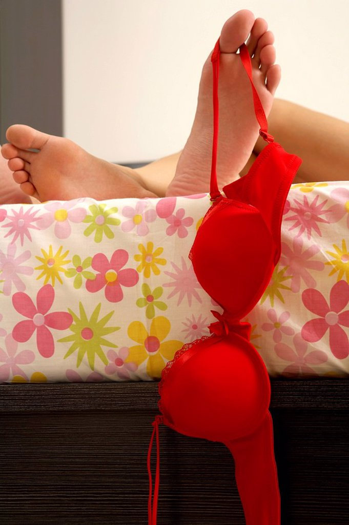 Stock Photo: 1839R-4228 Woman Dangling Brassiere From Foot