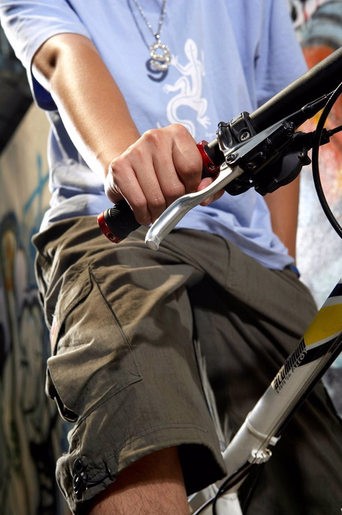 Close_Up Of Teenage Boy On A Bike : Stock Photo