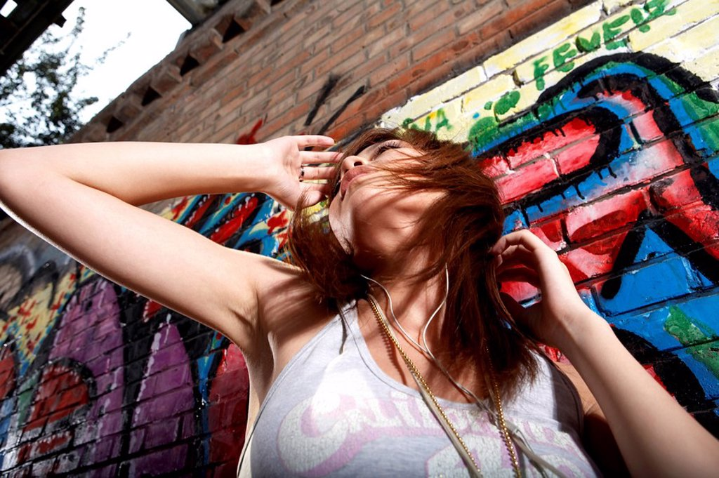 Stock Photo: 1839R-4490 Teenage Girl Dancing And Listening To Music