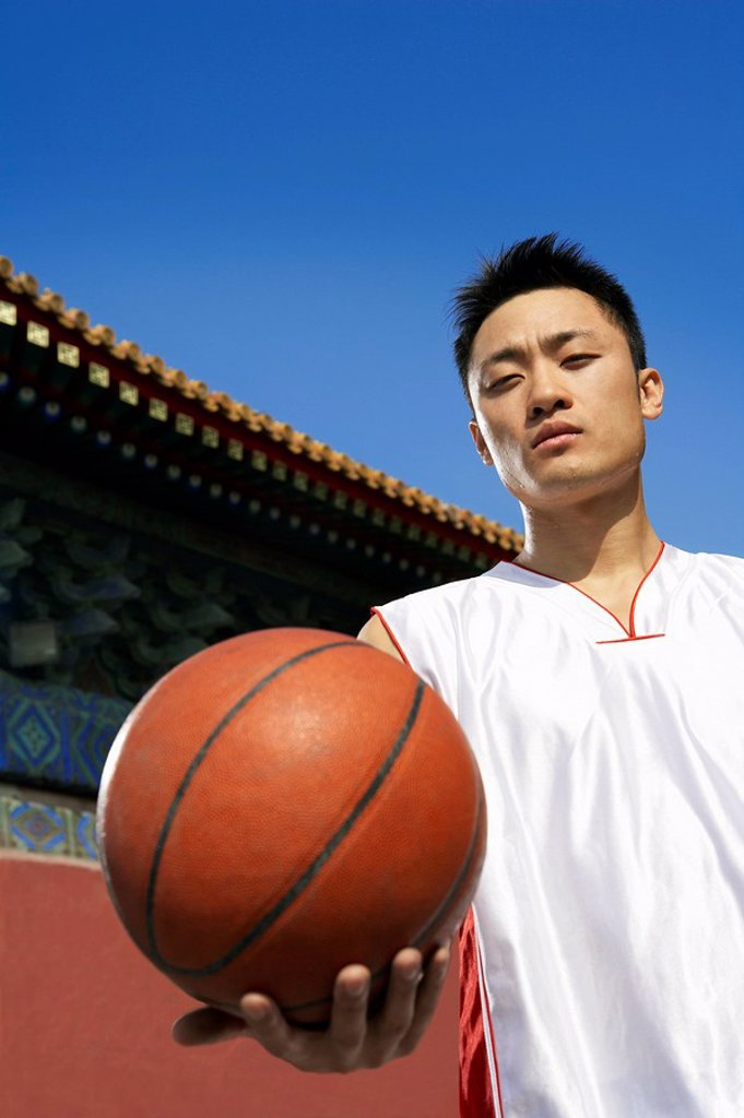Portrait Of Young Basketball Player In Front Of Temple : Stock Photo