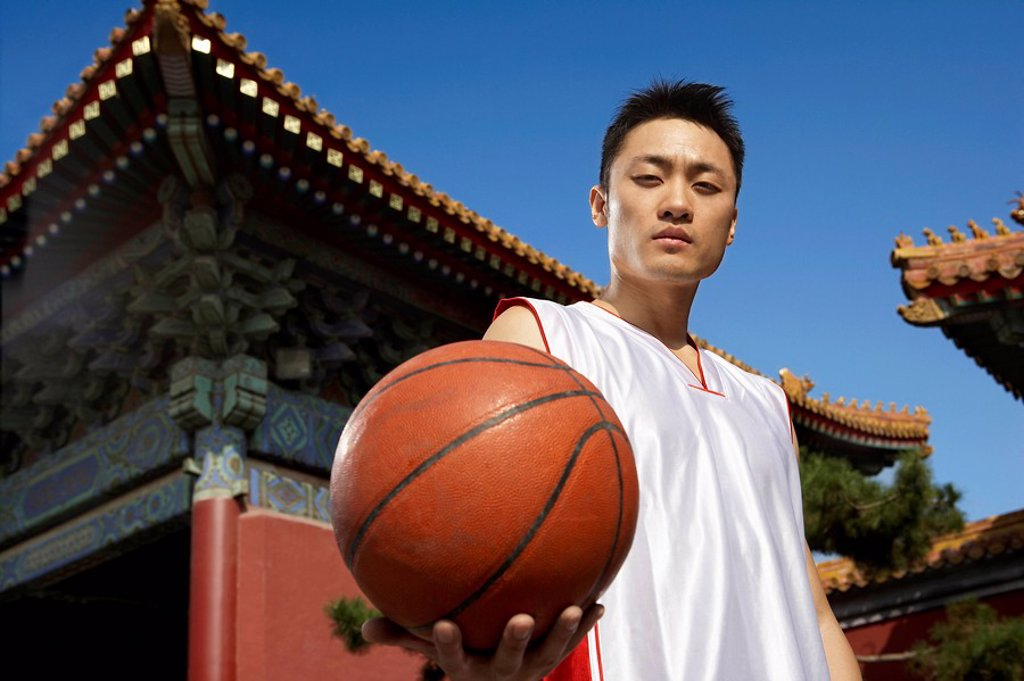 Stock Photo: 1839R-4799 Portrait Of Young Basketball Player In Front Of Temple