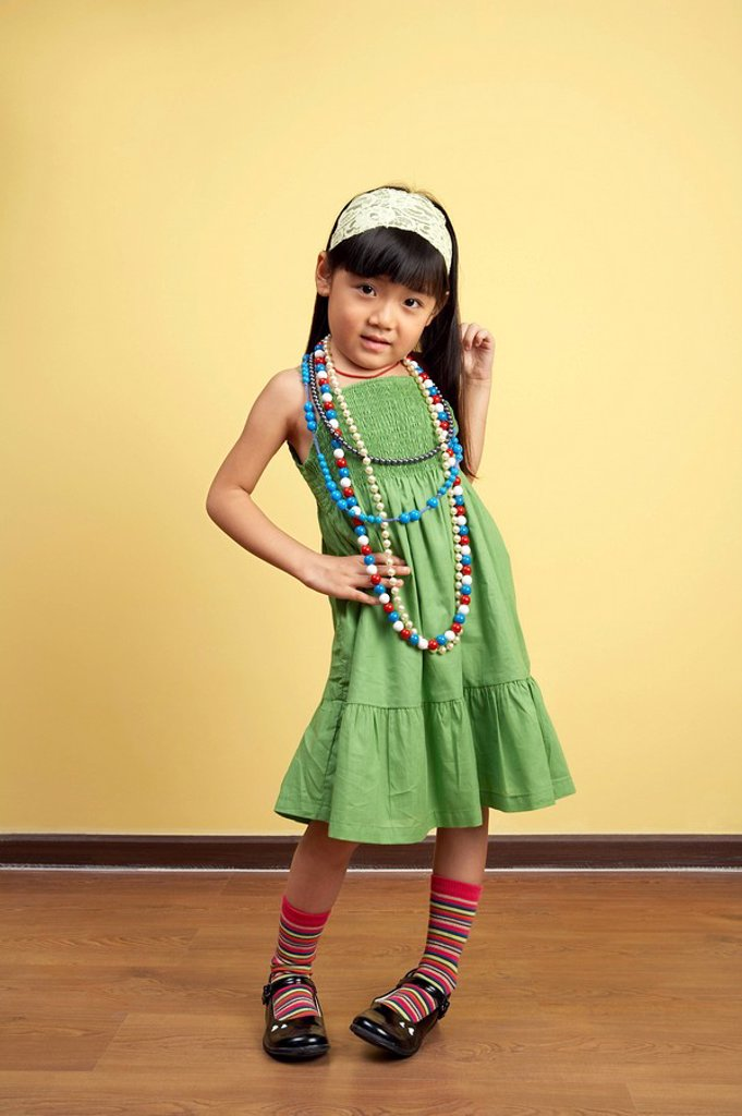 Stock Photo: 1839R-4883 Girl Posing With Hand On Hip