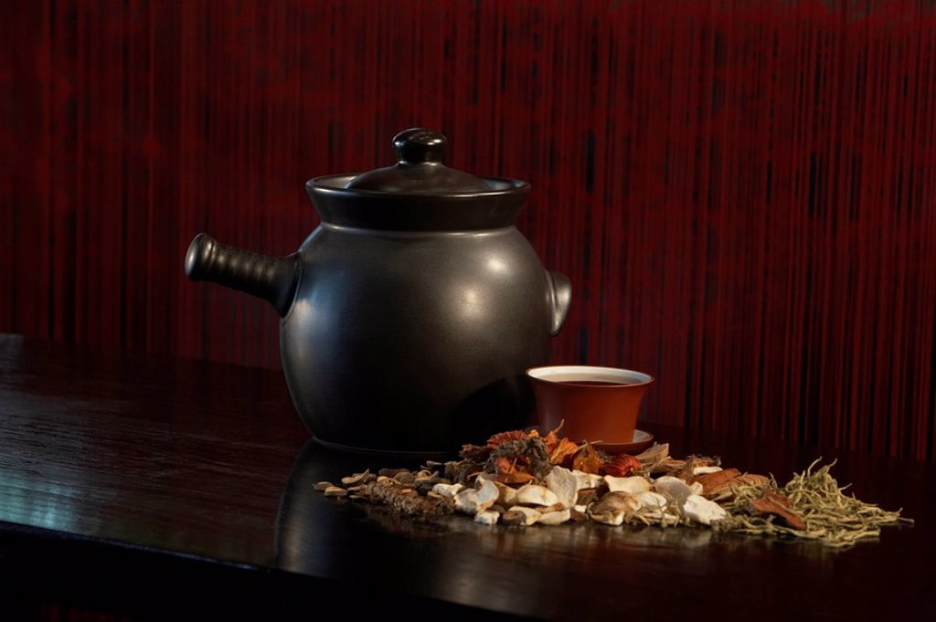 Stock Photo: 1839R-4959 Teapot With Cup And Loose Tea Leaves