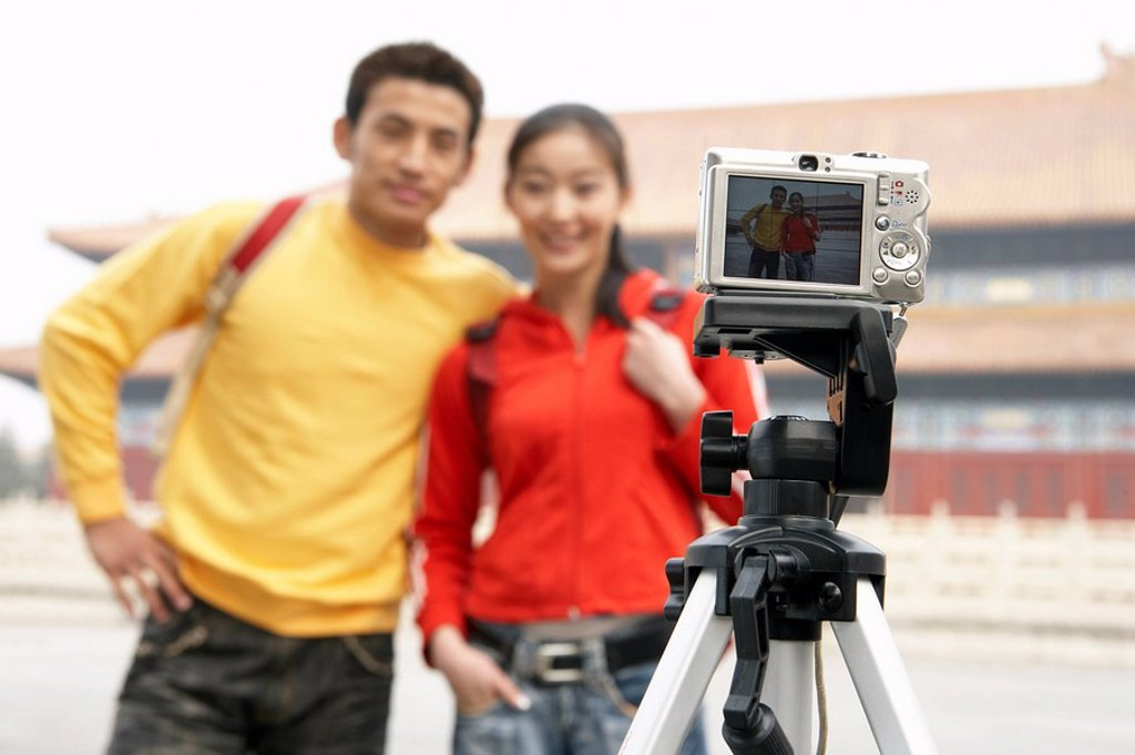 Young Couple Taking Picture Of Themselves In The Forbidden City, Beijing, China : Stock Photo