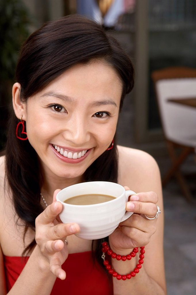 Stock Photo: 1839R-5194 Young Woman Drinking Cup Of Tea