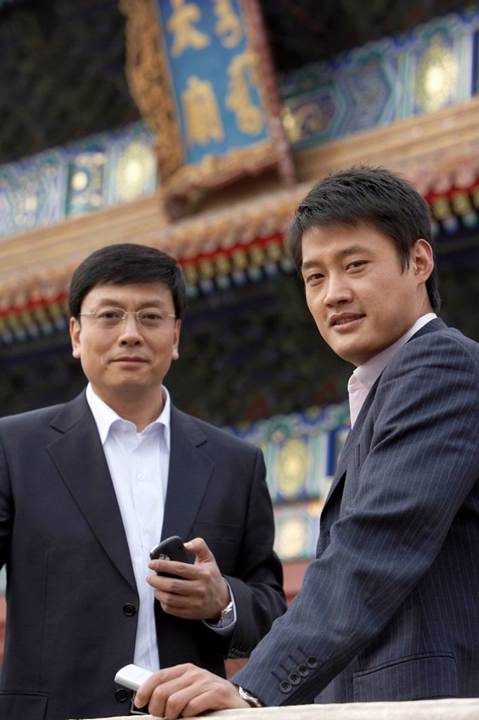 Stock Photo: 1839R-5445 Two Businessmen In The Forbidden City In Beijing