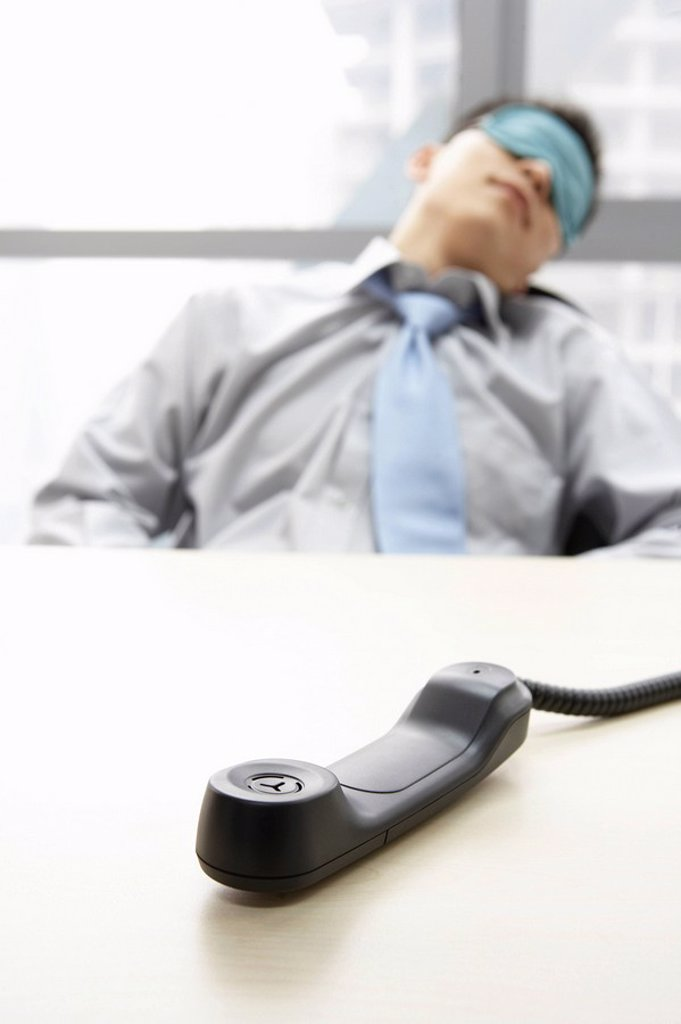 Phone Off Hook While Businessman Sleeps : Stock Photo