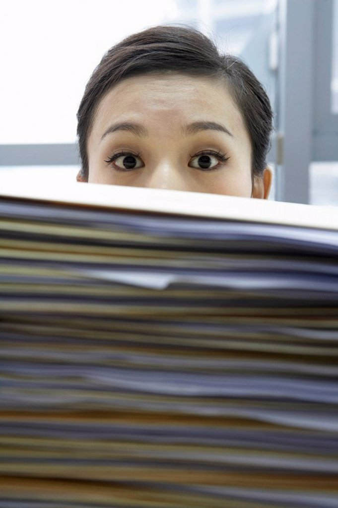 Stock Photo: 1839R-5744 Businesswoman With Pile Of Work
