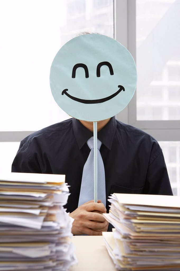 Stock Photo: 1839R-5750 Businessman With Smiley_Face Sign