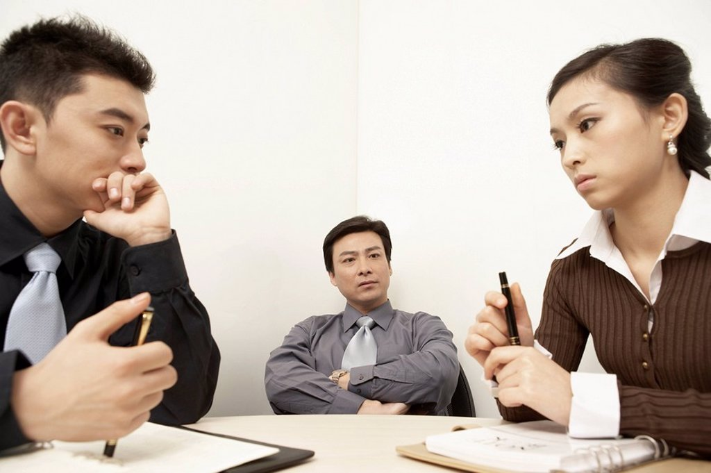 Businesspeople Having A Discussion In A Board Room : Stock Photo