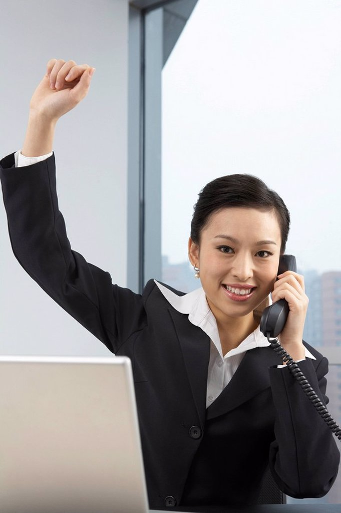 Businesswoman Talking On Phone, Cheering : Stock Photo