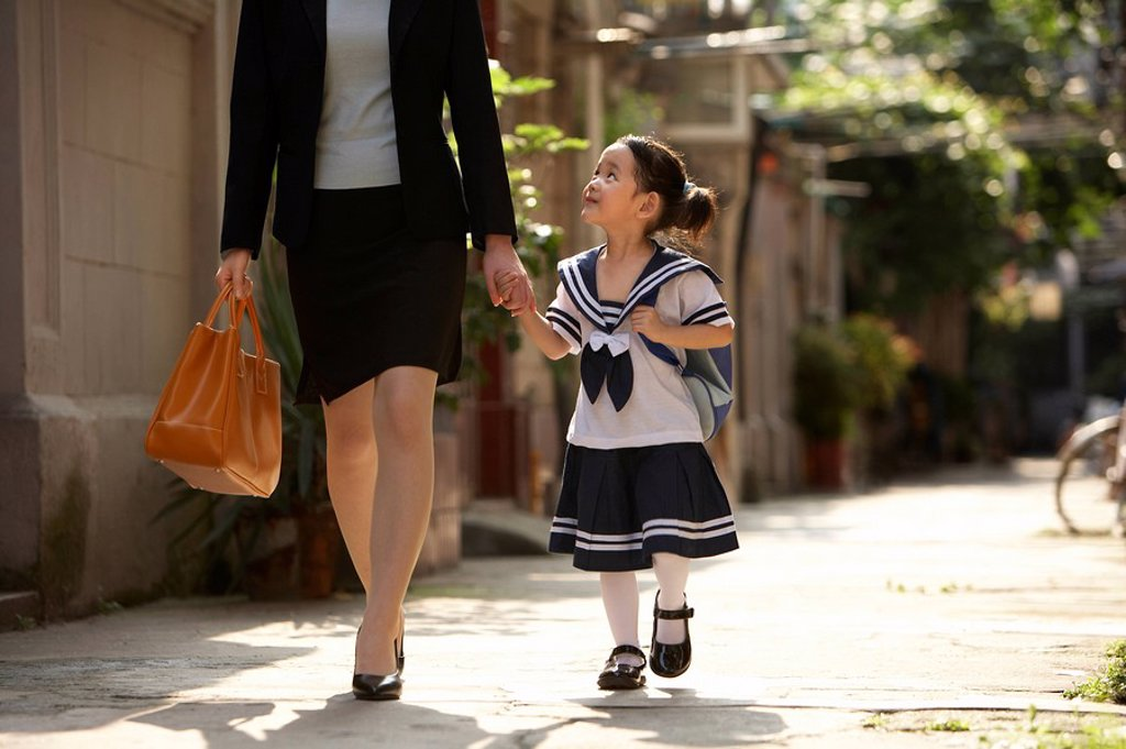 Stock Photo: 1839R-6564 A parent and child on the way to school in the morning
