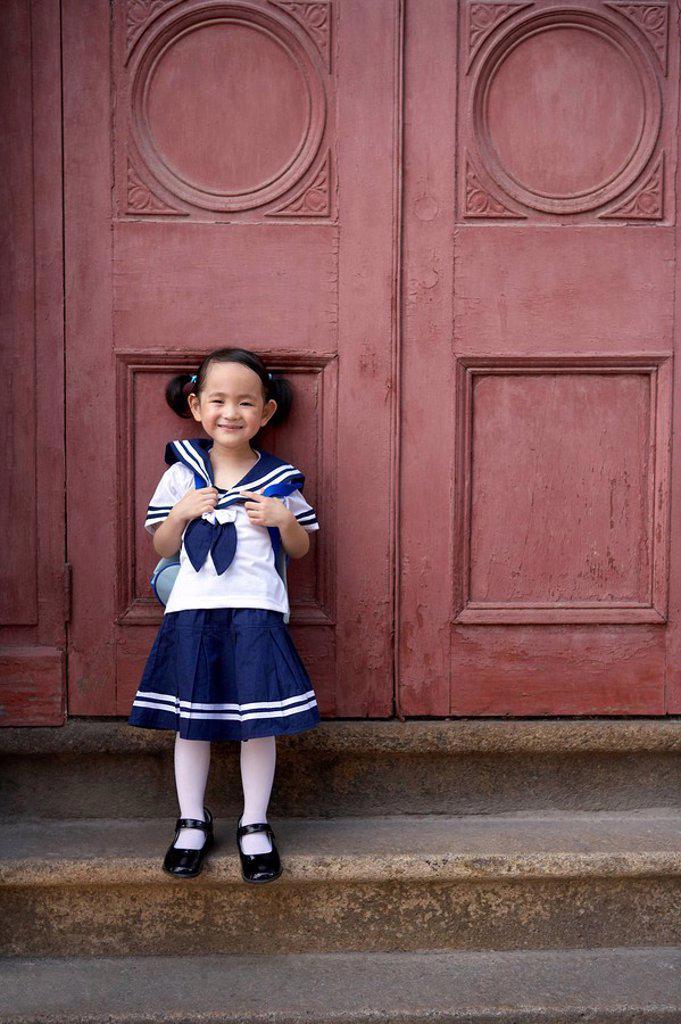 A child in her school uniform : Stock Photo