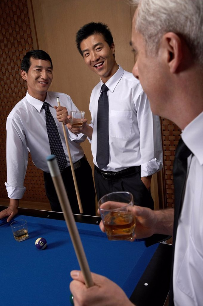 Professionals toast over billiards : Stock Photo