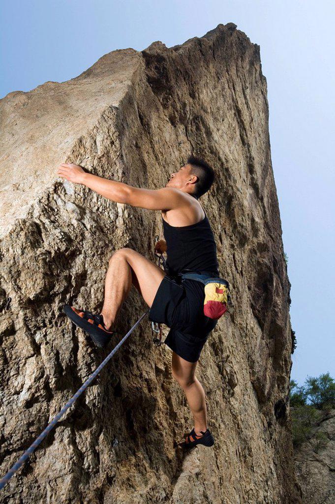 Stock Photo: 1839R-7067 Rock climbing