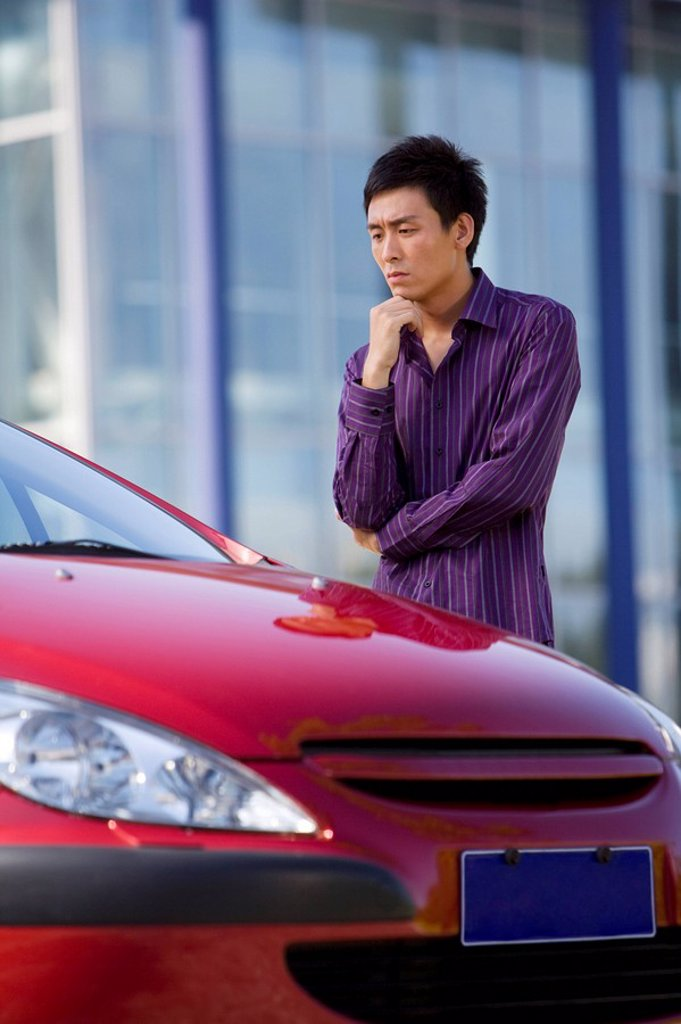 Man with a new car : Stock Photo