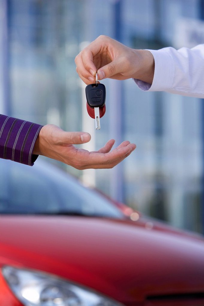 Stock Photo: 1839R-7318 Handing over keys to a new car