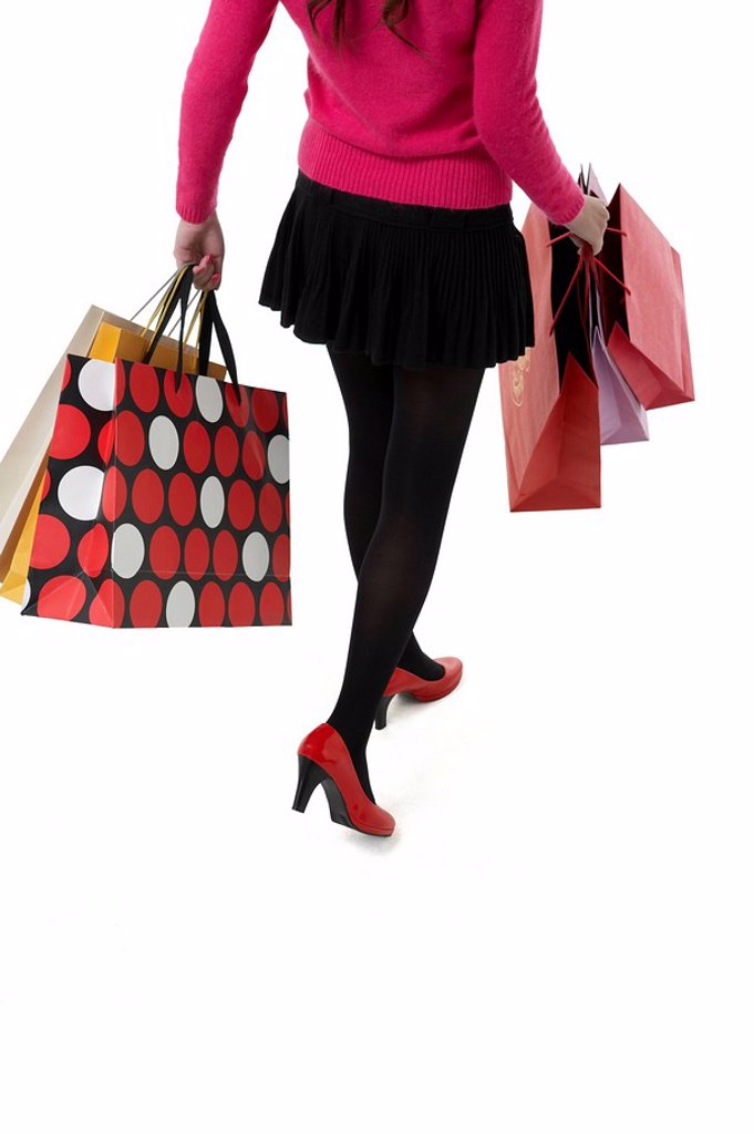 Stock Photo: 1839R-7762 High angle view of a woman walking with shopping bags