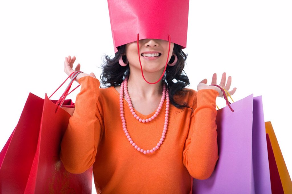 Stock Photo: 1839R-7835 Young woman with shopping bag over her head