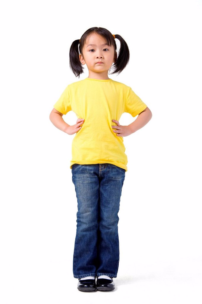 Stock Photo: 1839R-8004 Little girl stands with her hands on her hips