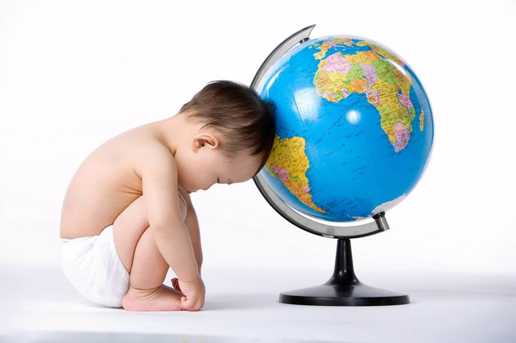 Infant with globe : Stock Photo