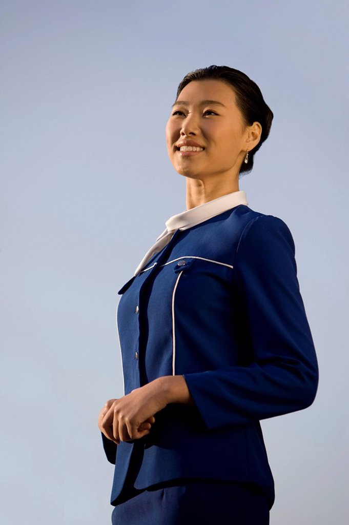 Stock Photo: 1839R-9043 Smiling Flight Attendant