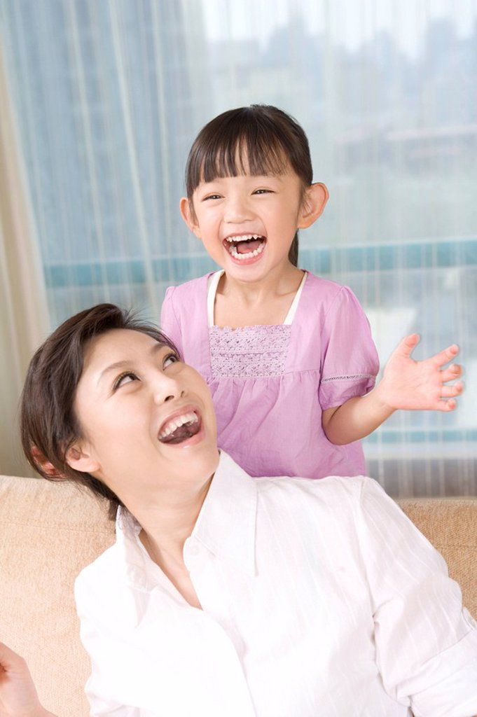Stock Photo: 1839R-9131 Mother and daughter playing together