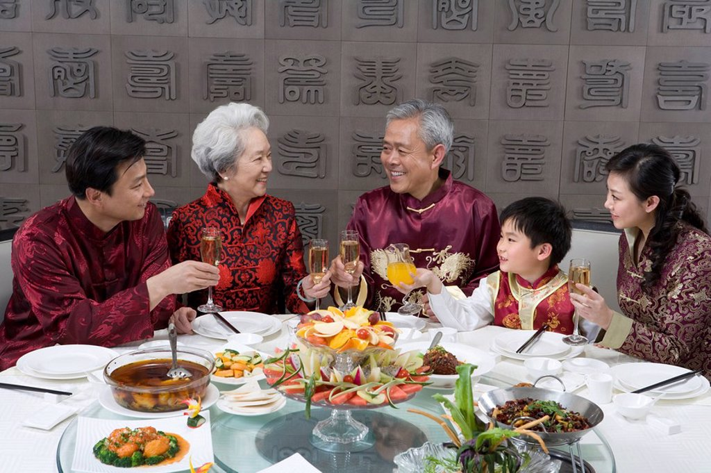 Chinese family celebrating at Chinese restaurant : Stock Photo