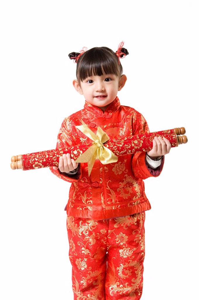 Young girl in Chinese traditional clothes holding scroll : Stock Photo