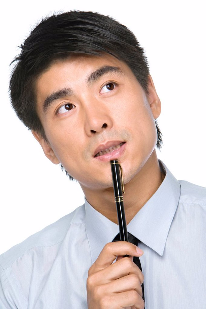 Young Businessman deep in thought : Stock Photo
