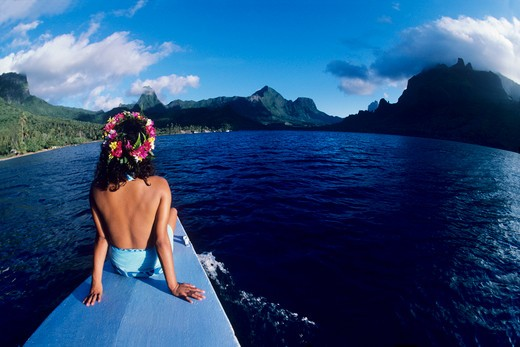 Tahitian girl on bow of boat in Cook's Bay on the island of Moorea, Society Islands, French Polynesia. : Stock Photo