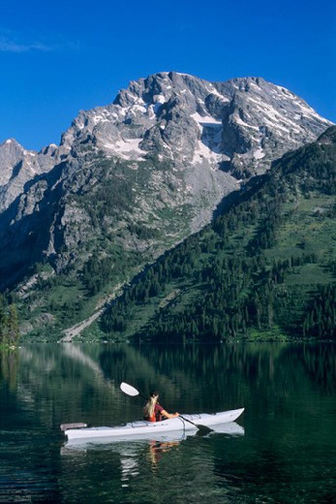 Kayaking on Leigh Lake below Mount Moran in Grand Teton National Park, Wyoming. : Stock Photo