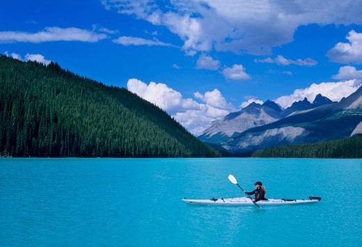 Stock Photo: 1840-13014 Kayaking on Mistaya Lake along the Icefields Parkway in the Canadian Rockies of Banff National Park, Alberta, Canada.