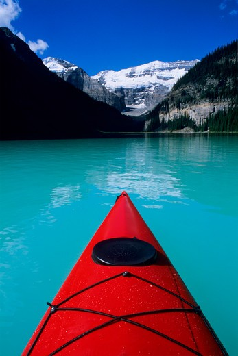 Kayak on Lake Louise below Mount Victoria in the Canadian Rockies; Banff National Park; Alberta, Canada : Stock Photo