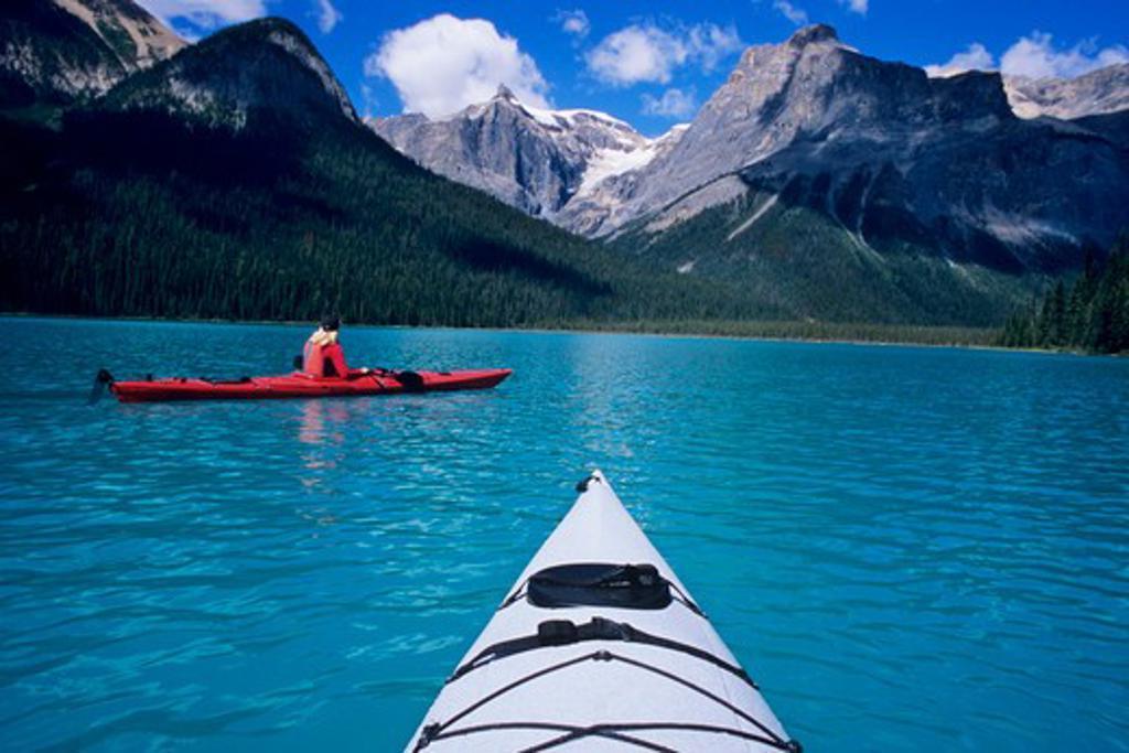 Kayaking on Emerald Lake beneath The President Range in Yoho National Park, British Columbia, Canada. : Stock Photo
