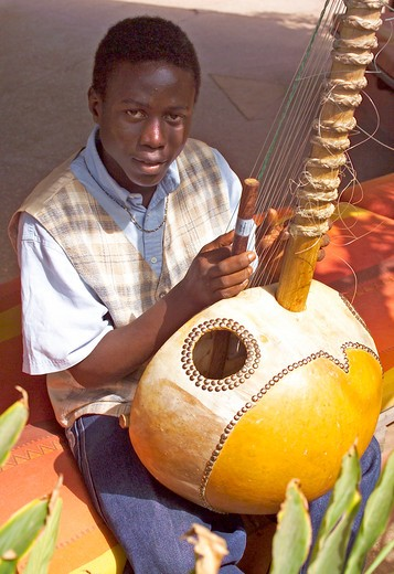 Stock Photo: 1840-15165 Boy Playing The Kora