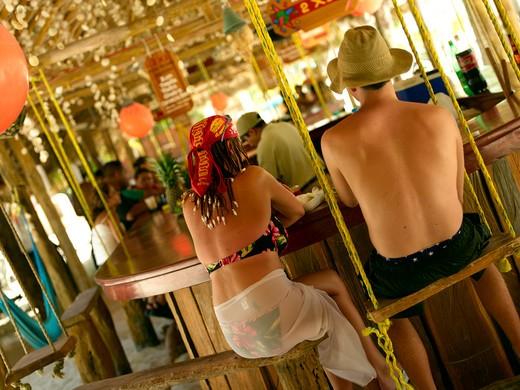 Stock Photo: 1840-19840 Isla Mujeres, Couple Drinking At Beach Bar