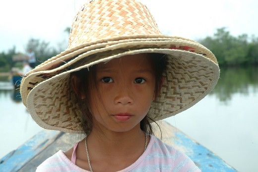 Young Girl Wearing Multiple Hats : Stock Photo