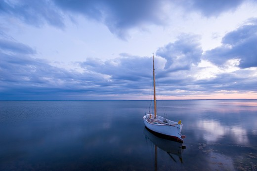 Stock Photo: 1840-26475 Moored Boat On Calm Water At Dusk, Puck Bay, Baltic Sea, Poland