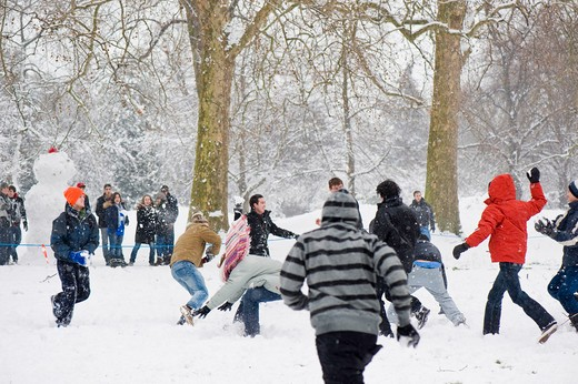 Stock Photo: 1840-26832 School children are having snowball fight in Kensington Gardens covered in February snow, SW7, London, United Kingdom