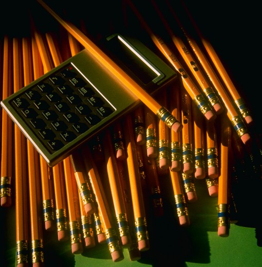 Yellow pencils and calculator : Stock Photo